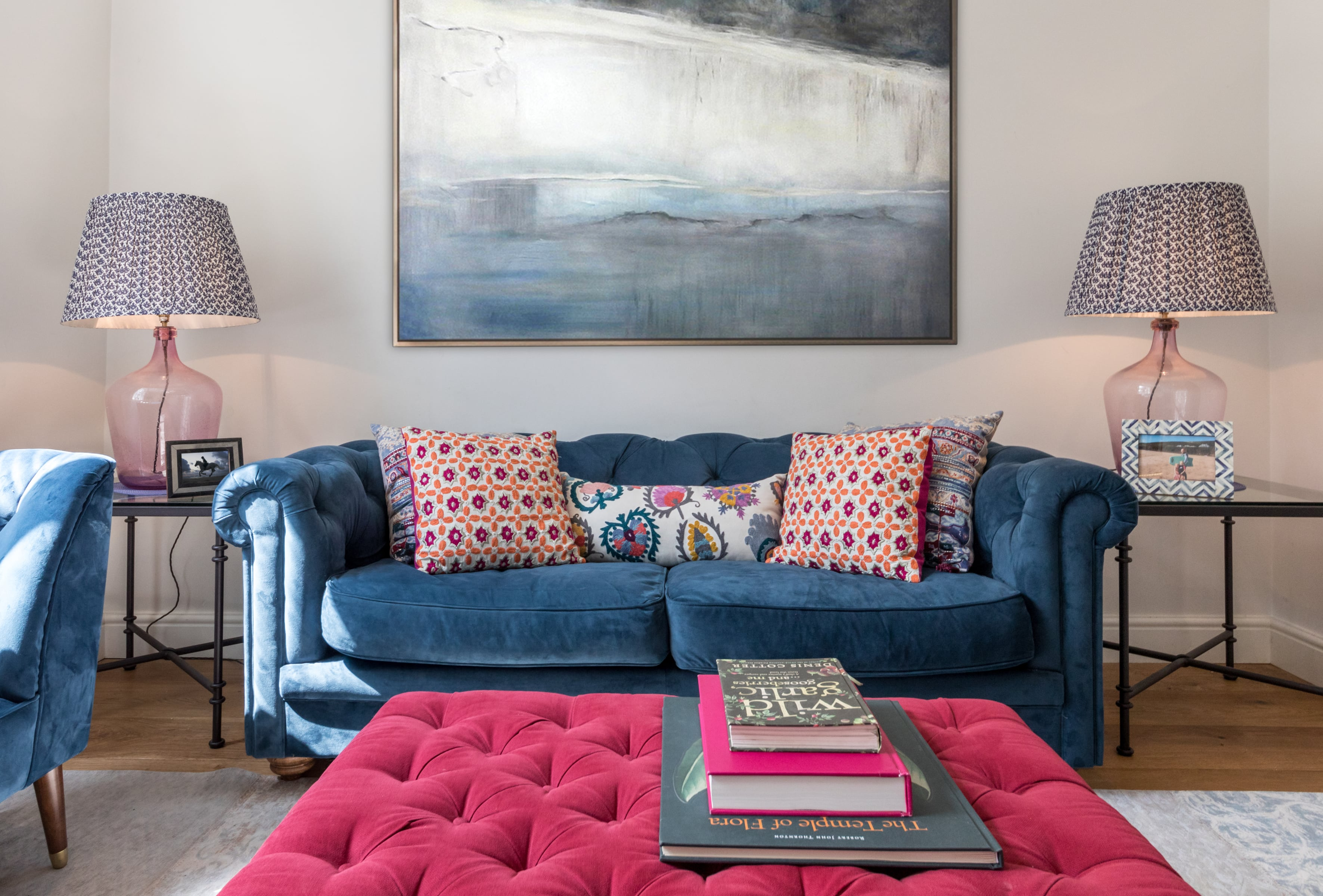 Luxury living room design with blue sofa and colourful cushions
